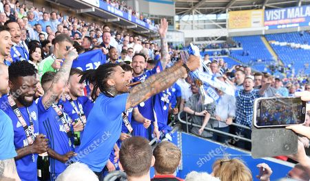 Armand Traore, of Cardiff, celebrates promotion to the Premier League,