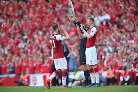 Stock Image of Calum Chambers of Arsenal is replaced by  Per Mertesacker of Arsenal
