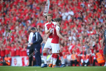Calum Chambers of Arsenal is replaced by  Per Mertesacker of Arsenal