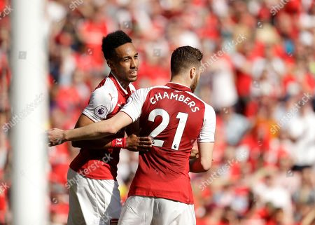 Arsenal's Pierre-Emerick Aubameyang, left, celebrates scoring his side's first goal with teammate Calum Chambers during the English Premier League soccer match between Arsenal and Burnley at the Emirates Stadium in London, . The match is Arsenal manager Arsene Wenger's last home game in charge after announcing in April he will stand down as Arsenal coach at the end of the season after nearly 22 years at the helm