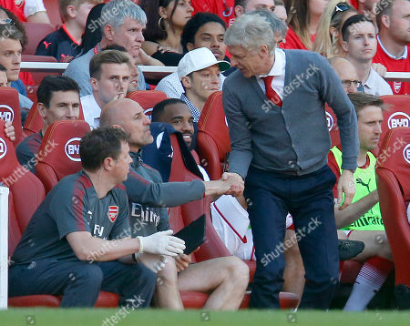 Arsene Wenger the Arsenal manager shakes hands with coach Steve Bould at the final whistle