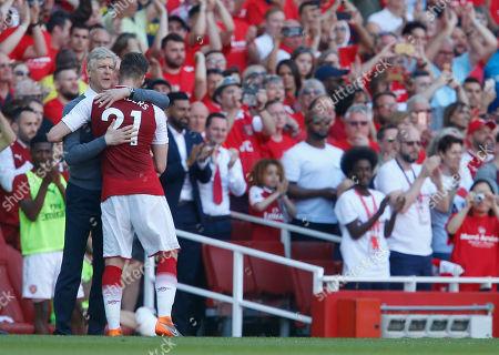 Arsene Wenger the Arsenal manager hugs Calum Chambers