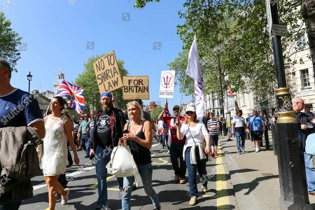 Controversial speakers including Tommy Robinson, Milo Yiannopoulos and Lauren Southern march to Whitehall for the Day Of Freedom rally. Anti fascist groups are also holding counter protests at the same time of the event.