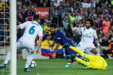 09 Luis Suarez from Uruguay of FC Barcelona defended by 06 Nacho from Spain of Real Madrid, 12 Marcelo Vieira da Silva from Brazil of Real Madrid and 01 Keylor Navas from Puerto Rico of Real Madrid