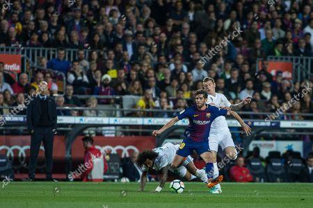 20 Sergi Roberto from Spain of FC Barcelona defended by 12 Marcelo Vieira da Silva from Brazil of Real Madrid