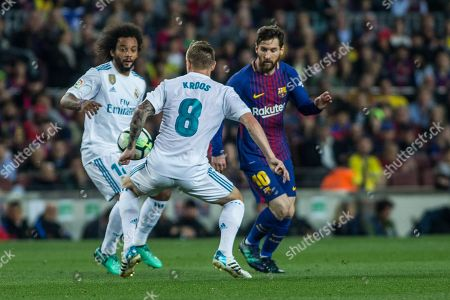 10 Lionel Messi from Argentina of FC Barcelona defended by 08 Toni Kroos from Germany of Real Madrid and 12 Marcelo Vieira da Silva from Brazil of Real Madrid