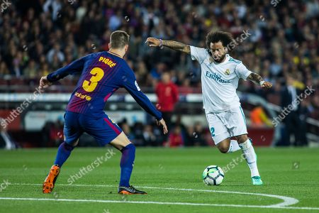 12 Marcelo Vieira da Silva from Brazil of Real Madrid defended by 03 Gerard Pique from Spain of FC Barcelona
