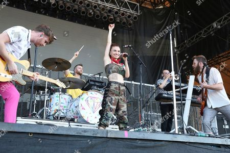 Marc Campbell, Etienne Bowler, Mandy Lee, Jesse Blum, William Hehir. From left, artists Marc Campbell, Etienne Bowler, Mandy Lee, Jesse Blum and William Hehir of MisterWives perform on the FedEx Stage at Beale Street Music Festival on in Memphis, Tenn