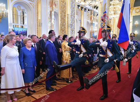 Stock Picture of Svetlana Medvedeva (L), the wife of Russian Prime Minister Dmitry Medvedev, and Naina Yeltsina (2-L), the widow of former Russian President Boris Yeltsin, watch honour guards carring the Russian National Flag (R) and the Russian Presidential Standard (L) during an inauguration ceremony of Vladimir Putin as Russian President in the Kremlin, in Moscow, Russia, 07 May 2018. Vladimir Putin won his fourth term in the Kremlin during presidential elections on 18 March 2018.