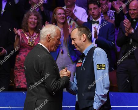 Mark Williams of Wales is congratulated by Barry Hearn after winning the final match