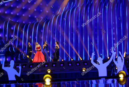 Presenters Daniela Ruah, Silvia Alberto, Catarina Furtado and Filomena Cautela, from left to right, stand on stage in Lisbon, Portugal, during a dress rehearsal for the Eurovision Song Contest. The Eurovision Song Contest semifinals take place in Lisbon on Tuesday, May 8 and Thursday, May 10, the grand final on Saturday May 12, 2018