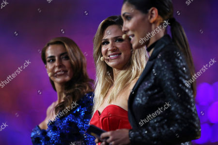 Presenters Catarina Furtado, Silvia Alberto, and Daniela Ruah, from left to right, stand on stage in Lisbon, Portugal, during a dress rehearsal for the Eurovision Song Contest. The Eurovision Song Contest semifinals take place in Lisbon on Tuesday, May 8 and Thursday, May 10, the grand final on Saturday May 12, 2018