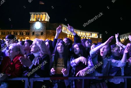 Armenians fans cheer during concert to support the opposition lawmaker Nikol Pashinian in Yerevan, Armenia, . Nikol Pashinian, who led weeks of protests that attracted tens of thousands of people and forced Serzh Sargsyan to resign as premier, is expected to be chosen as prime minister by parliament Tuesday