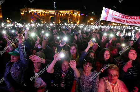 People hold up their mobile phone lights during a concert to support the opposition lawmaker Nikol Pashinian in Yerevan, Armenia, . Nikol Pashinian, who led weeks of protests that attracted tens of thousands of people and forced Serzh Sargsyan to resign as premier, is expected to be chosen as prime minister by parliament Tuesday