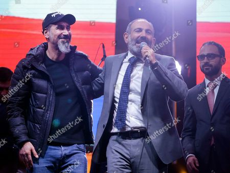 The Armenian-American singer Serj Tankian of System of a Down, left, and opposition lawmaker Nikol Pashinian greet fans during a concert in Yerevan, Armenia, . Nikol Pashinian, who led weeks of protests that attracted tens of thousands of people and forced Serzh Sargsyan to resign as premier, is expected to be chosen as prime minister by parliament Tuesday