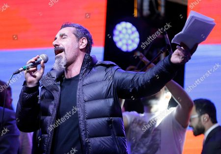 Stock Image of The Armenian-American singer Serj Tankian of System of a Down addresses the crowd gathered in Republic Square during a concert in Yerevan, Armenia, . Opposition lawmaker Nikol Pashinian, who led weeks of protests that attracted tens of thousands of people and forced Serzh Sargsyan to resign as premier, is expected to be chosen as prime minister by parliament Tuesday