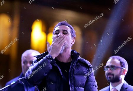 The Armenian-American singer Serj Tankian of System of a Down sends out a kiss to the crowd gathered in Republic Square during a concert in Yerevan, Armenia, . Opposition lawmaker Nikol Pashinian, who led weeks of protests that attracted tens of thousands of people and forced Serzh Sargsyan to resign as premier, is expected to be chosen as prime minister by parliament Tuesday