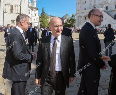 Stock Photo of First Deputy Head of the Presidential Administration of Russia Sergei Kiriyenko (center) and TV presenter Andrei Kondrashov (right) before the ceremony