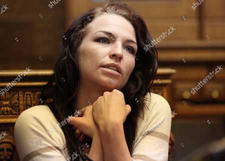 """Kiersten Pyke speaks during a press conference at her attorneys office, in Salt Lake City. Pyke, a Utah woman who told police Tom Sizemore groped her at a photo shoot when she was 11, is suing the actor. The lawsuit filed Monday says the 2003 incident during production of the """"Born Killers"""" movie left her with post-traumatic stress and drug and alcohol addiction"""