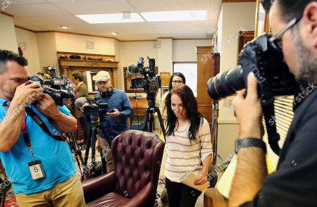 """Kiersten Pyke arrives for a press conference at her attorneys office, in Salt Lake City. Pyke, a Utah woman who told police Tom Sizemore groped her at a photo shoot when she was 11, is suing the actor. The lawsuit filed Monday says the 2003 incident during production of the """"Born Killers"""" movie left her with post-traumatic stress and drug and alcohol addiction"""