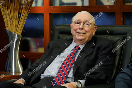 """Berkshire Hathaway Vice Chairman Charlie Munger smiles during an interview in Omaha, Neb., with Liz Claman on Fox Business Network's """"Countdown to the Closing Bell"""