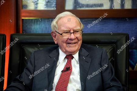 """Berkshire Hathaway Chairman and CEO Warren Buffett smiles during an interview in Omaha, Neb., with Liz Claman on Fox Business Network's """"Countdown to the Closing Bell"""