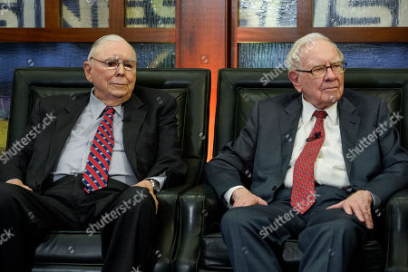 """Charlie Munger, Warren Buffett. Berkshire Hathaway Chairman and CEO Warren Buffett, right, and his Vice Chairman Charlie Munger, left, listen to a question during an interview in Omaha, Neb., with Liz Claman on Fox Business Network's """"Countdown to the Closing Bell"""