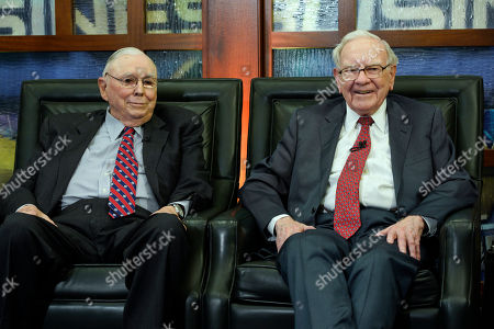 """Charlie Munger, Warren Buffett. Berkshire Hathaway Chairman and CEO Warren Buffett, right, and his Vice Chairman Charlie Munger, left, smile during an interview in Omaha, Neb., with Liz Claman on Fox Business Network's """"Countdown to the Closing Bell"""