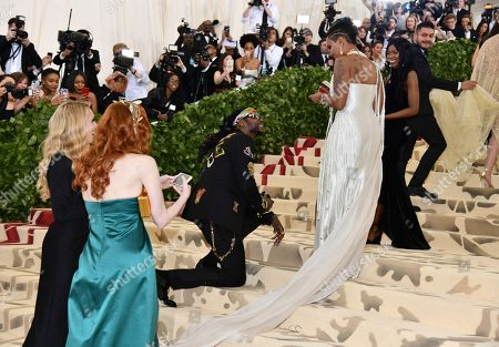 2 Chainz, Kesha Ward. 2 Chainz, kneeling, and Kesha Ward attend The Metropolitan Museum of Art's Costume Institute benefit gala celebrating the opening of the Heavenly Bodies: Fashion and the Catholic Imagination exhibition, in New York