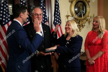 Paul Ryan, Debbie Lesko. Speaker of the House Paul Ryan of Wis., left, holds a ceremonial swearing-in for Rep-elect Debbie Lesko, R-Ariz., second from right, accompanied by her family, at the Capitol in Washington