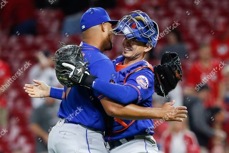 Jeurys Familia, Adrian Gonzalez. New York Mets relief pitcher Jeurys Familia, left, and first baseman Adrian Gonzalez, right, celebrate after closing the ninth inning of a baseball game against the Cincinnati Reds, in Cincinnati