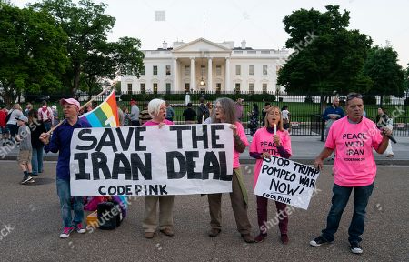Stock Photo of Sergei Kostin, Paki Wieland, Leah Brown, Medea Benjamin, Tighe Barry. Members of Code Pink, from left, Sergei Kostin, Paki Wieland, Leah Brown, Medea Benjamin and Tighe Barry rally in support of Iran's nuclear deal with world powers in front of the White House in Washington, . President Donald Trump is set to reveal his decision on whether to keep the U.S. in the Iran deal on Tuesday, a move that could determine the fate of 2015 agreement that froze Iran's nuclear program
