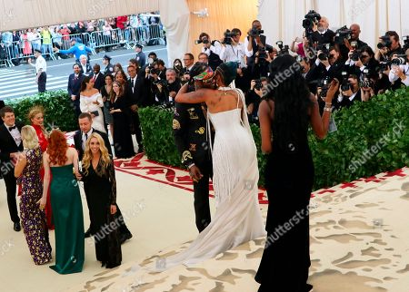 2 Chainz and Kesha Ward, center, embrace as they arrive at The Metropolitan Museum of Art's Costume Institute benefit gala celebrating the opening of the Heavenly Bodies: Fashion and the Catholic Imagination exhibition, in New York