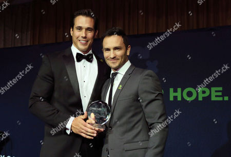 Stock Image of Jeremy Bloom, Brady Quinn. Former Olympic skier and former NFL player Jeremy Bloom, right, presents the Leadership in Community Award to former NFL and legendary Notre Dame quarterback Brady Quinn, left, at the Kelly Cares Foundation's Irish Eyes Gala, in New York. Celebrating its 10th year, the Kelly Cares Foundation has donated more than $4.2 million to support health and education initiatives around the world