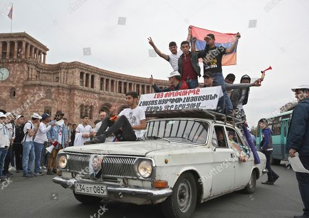 Stock Picture of Supporters of opposition lawmaker Nikol Pashinian react as they drive by Republic Square in Yerevan, Armenia, . The Armenian opposition who is nearly certain to become the country's prime minister says he will not seek political revenge in the wake of the past month of tensions. Pashinian, who led weeks of protests that attracted tens of thousands of people and forced Serzh Sargsyan to resign as premier, is expected to be chosen prime minister by parliament on Tuesday