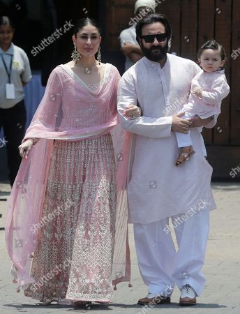 Saif Ali Khan, Taimur Ali Khan, Kareena Kapoor. Bollywood actor Saif Ali Khan, right, along with his son Taimur Ali Khan and his wife Kareena Kapoor poses for photographs as they arrive to attend the wedding cermony of Bollywood actress Sonam Kapoor in Mumbai, India