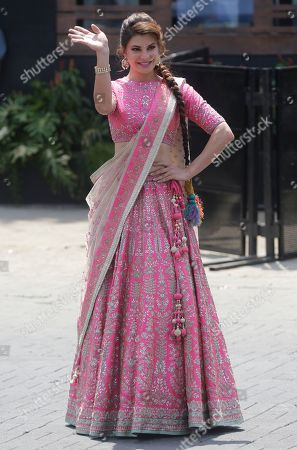 Bollywood actress Jacqueline Fernandez waves to media persons as she arrives to attend the marriage cermony of Bollywood actress Sonam Kapoor in Mumbai, India
