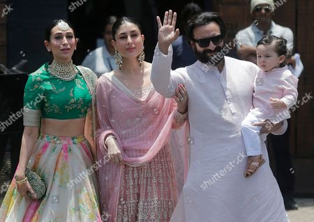 Saif Ali Khan, Taimur Ali Khan, Kareena Kapoor, Karishma Kapoor. Bollywood actor Saif Ali Khan, right, along with his son Taimur Ali Khan, wife Kareena Kapoor, centre and sister in law Karishma Kapoor, left, poses for photographs as they arrive to attend the wedding cermony of Bollywood actress Sonam Kapoor in Mumbai, India