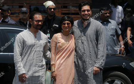 Aamir Khan, Kiran Rao, Junaid Khan. Bollywood actor Aamir Khan, left, poses for photographs with his wife Kiran Rao, center, and son Junaid Khan as they arrive to attend the marriage cermony of Bollywood actress Sonam Kapoor in Mumbai, India