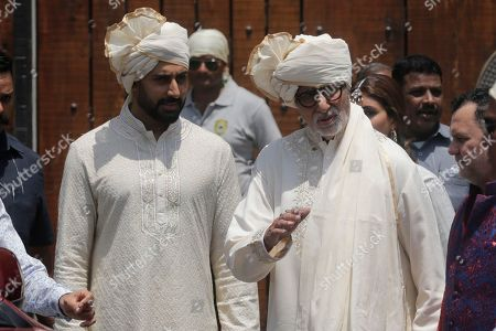 Amitabh Bachchan, Abhishek Bachchan. Bollywood actor Amitabh Bachchana, right, along with son Abhishek Bachchan leaves after attending the marriage cermony of Bollywood actress Sonam Kapoor in Mumbai, India