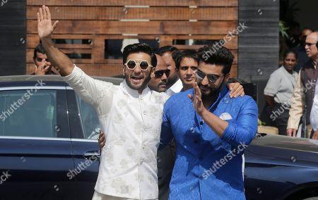 Ranveer Singh, Arjun Kapoor. Bollywood actors Ranveer Singh, left, along with Arjun Kapoor leaves after attending the marriage cermony of Bollywood actress Sonam Kapoor in Mumbai, India