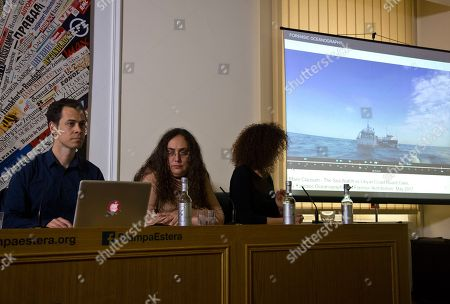 Stock Image of From left, Charles Heller, co-founder of Forensic Oceanography, ASGI lawyer Loredana Leo, and ARCI's Sara Prestianni, attend a press conference at the Foreign Press Club in Rome, to explain a case filed with the European Court of Human Rights by 17 Nigerian survivors of a 2017 migrant boat sinking, backed by Forensic Oceanography, alleging Italy was responsible for human rights violations in Libya