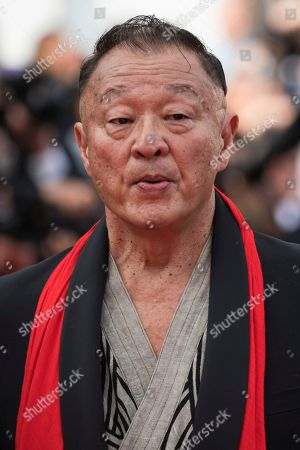 Stock Photo of Cary Hiroyuki Tagawa poses for photographers upon arrival at the opening ceremony of the 71st international film festival, Cannes, southern France