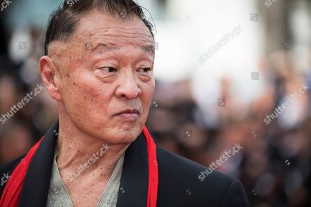 Cary Hiroyuki Tagawa poses for photographers upon arrival at the opening ceremony of the 71st international film festival, Cannes, southern France