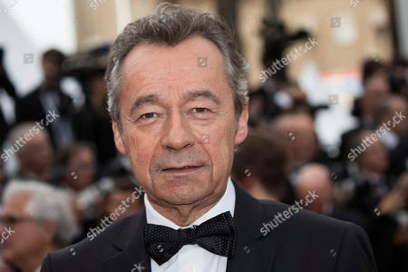 Michel Denisot poses for photographers upon arrival at the opening ceremony of the 71st international film festival, Cannes, southern France