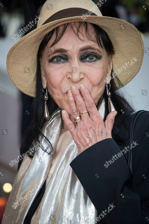 Anna Karina poses for photographers upon arrival at the opening ceremony of the 71st international film festival, Cannes, southern France