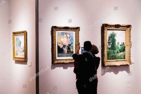 People attend the viewing of the Collection of Peggy and David Rockefeller at Christie's auction house in New York, New York, USA, 08 May 2018. The artworks on show are part of the 'Collection of Peggy and David Rockefeller: 19th and 20th Century Art Evening Sale' that takes place in New York from 08 to 10 May 2018.