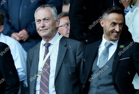 Richard Scudamore Chief Executive of the Premier League watches on.