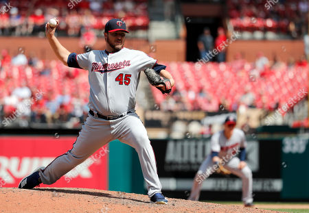 Minnesota Twins relief pitcher Phil Hughes throws during the ninth inning of a baseball game against the St. Louis Cardinals, in St. Louis. The Twins won 7-1