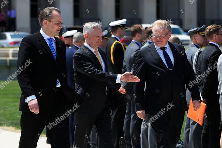 Jim Mattis, Jussi Niinist', Peter Hultqvist. Secretary of Defense Jim Mattis, center, with Finland's Minister of Defense Jussi Niinistö left, and Sweden's Minister of Defense Peter Hultqvist, right, gestures during an Armed Forces full honor arrival and trilateral ceremony at the Pentagon